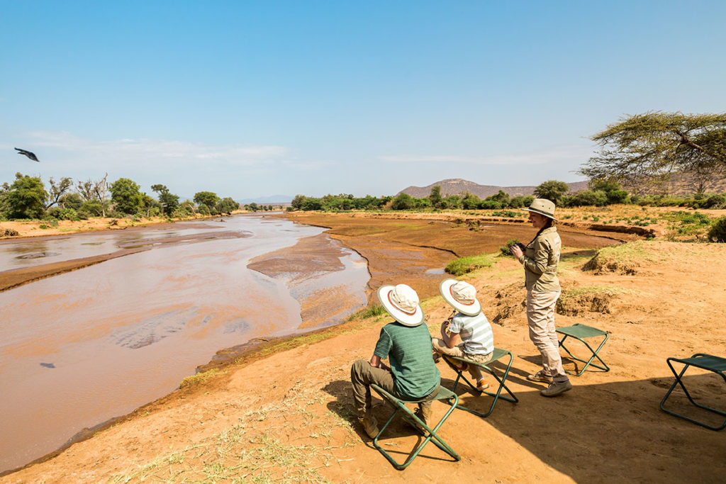 Kids on safari, by BlueOrange Studio, Shutterstock. Travel Africa magazine